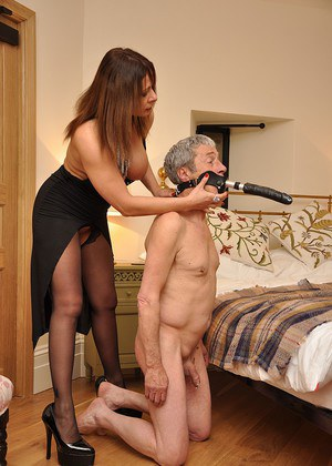 Mistress Carly pleasures herself on the bed until her slave arrives with the dildo