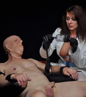 Nurse Carly puts her submissives cock in a pump and drains all of his hot cum.